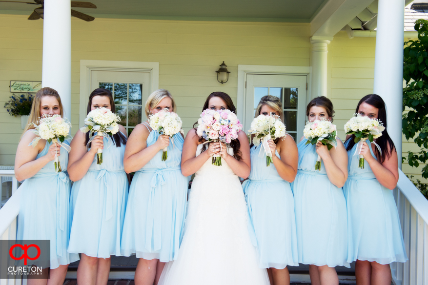 The bridesmaids on the steps of the house at Lenora's Legacy.