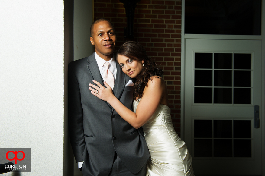 A bride and groom posing before their wedding reception at Upcountry History Museum.