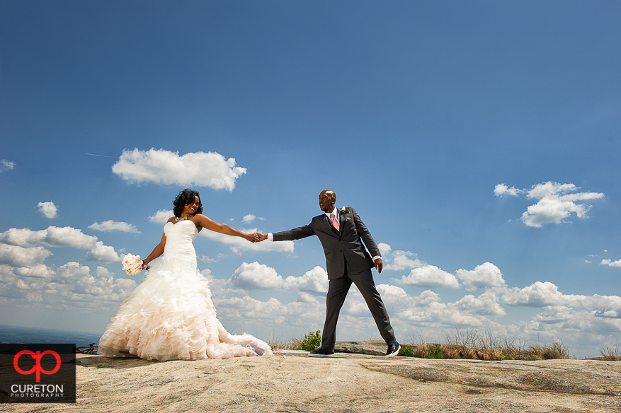 Rochelle and Reggie after their wedding  at the Cliffs of Glassy Chapel.