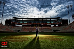 A couple kissing on the football field at Death Valley in Clemson during an engagement photo session.