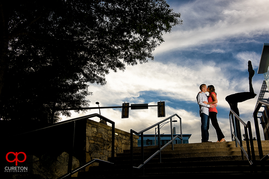 Couple kissing in Falls Park during a recent Greenville,SC engagement session.
