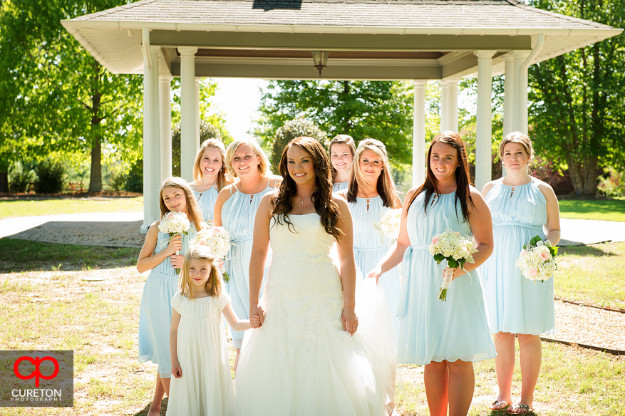 The bridesmaids walking into the meadow.