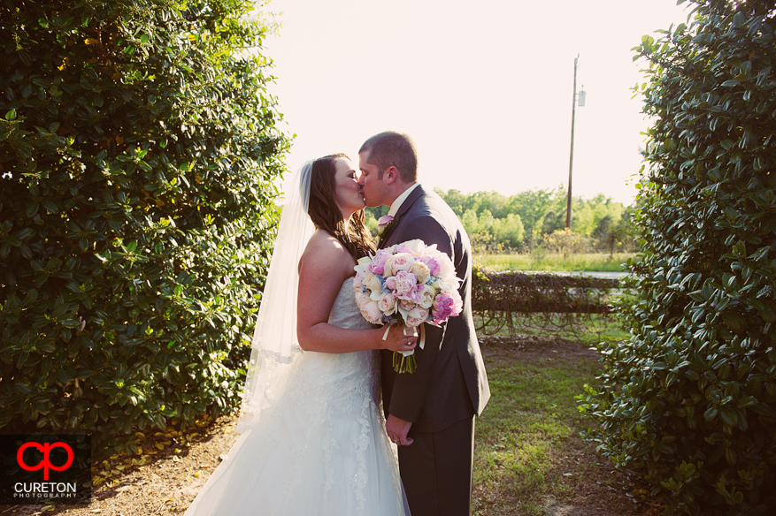 Couple kissing after their wedding.
