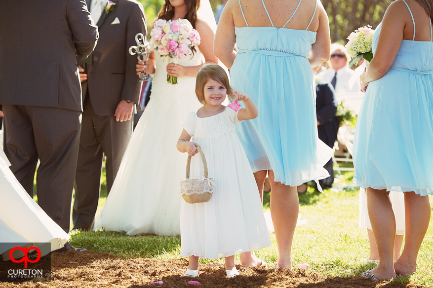 Flowergirl smiling during the wedding.