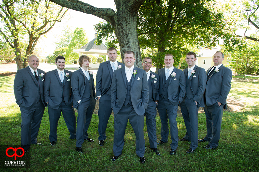The groomsmen in the meadow.