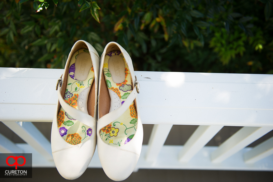 Bride's shoes on a railing.