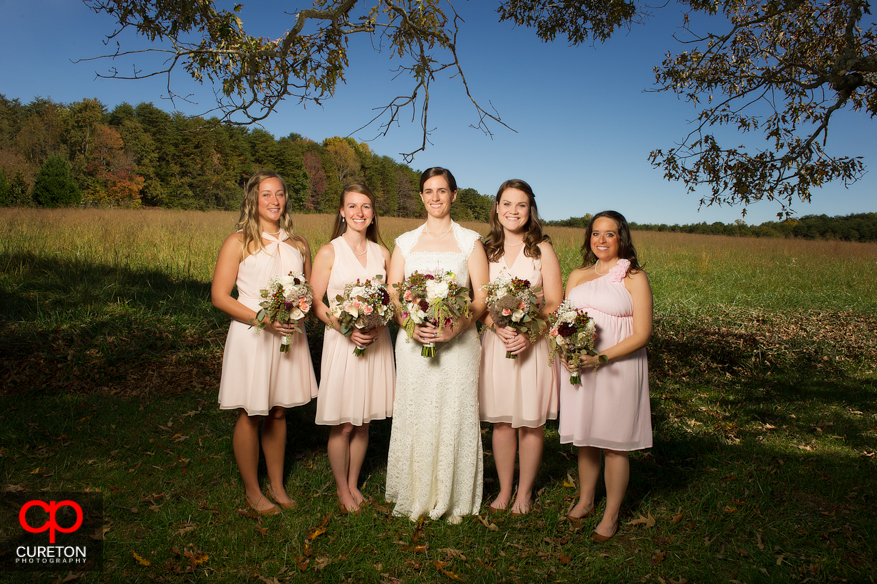 Bride and her bridesmaids before wedding.