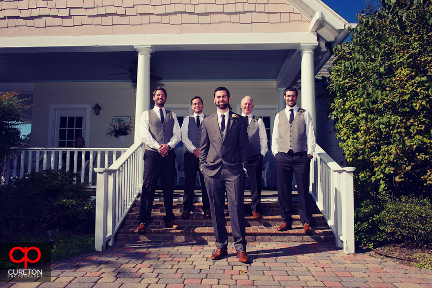 Groomsmen on the steps at Lenora's Legacy.