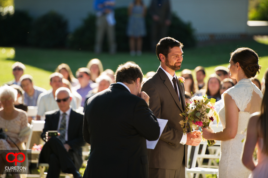 Groom looks at his bride during the ceremony.