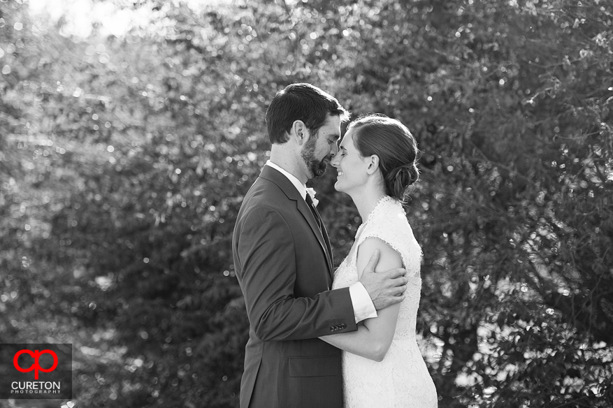 Black and white photo of bride and groom at Lenora's Legacy.