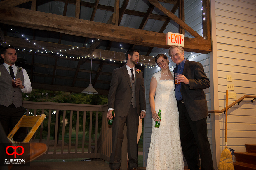 Father of the bride toasts the couple.