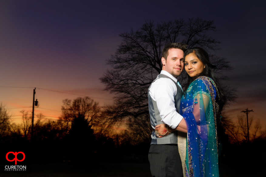 Couple posing at sunset after their Greenville SC Indian Wedding.