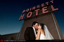 A couple kissing after thier wedding on the roof of the Westin Poinsett in Greenville,SC.