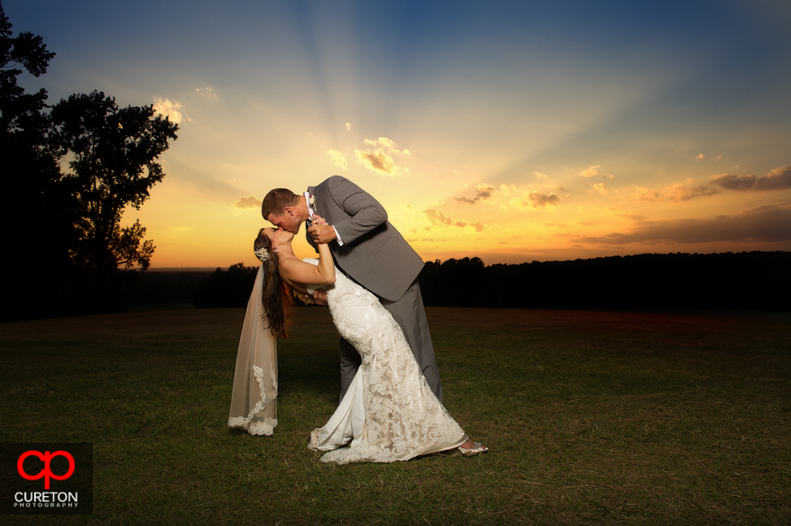 A bride and groom at sunset after their San Souci Farms wedding in Sumter,SC.