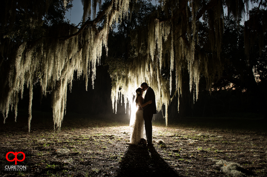 A shot of a bride and groom at San Souci Farms by Sumter Wedding Photographers Cureton Photography.