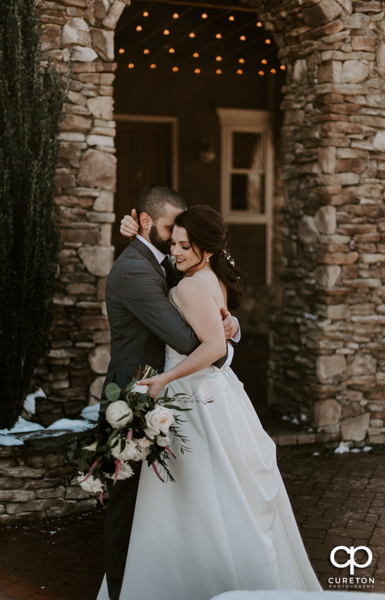 Bride and Groom snuggling before their January wedding at The Arbors event venue in Cleveland, NC.