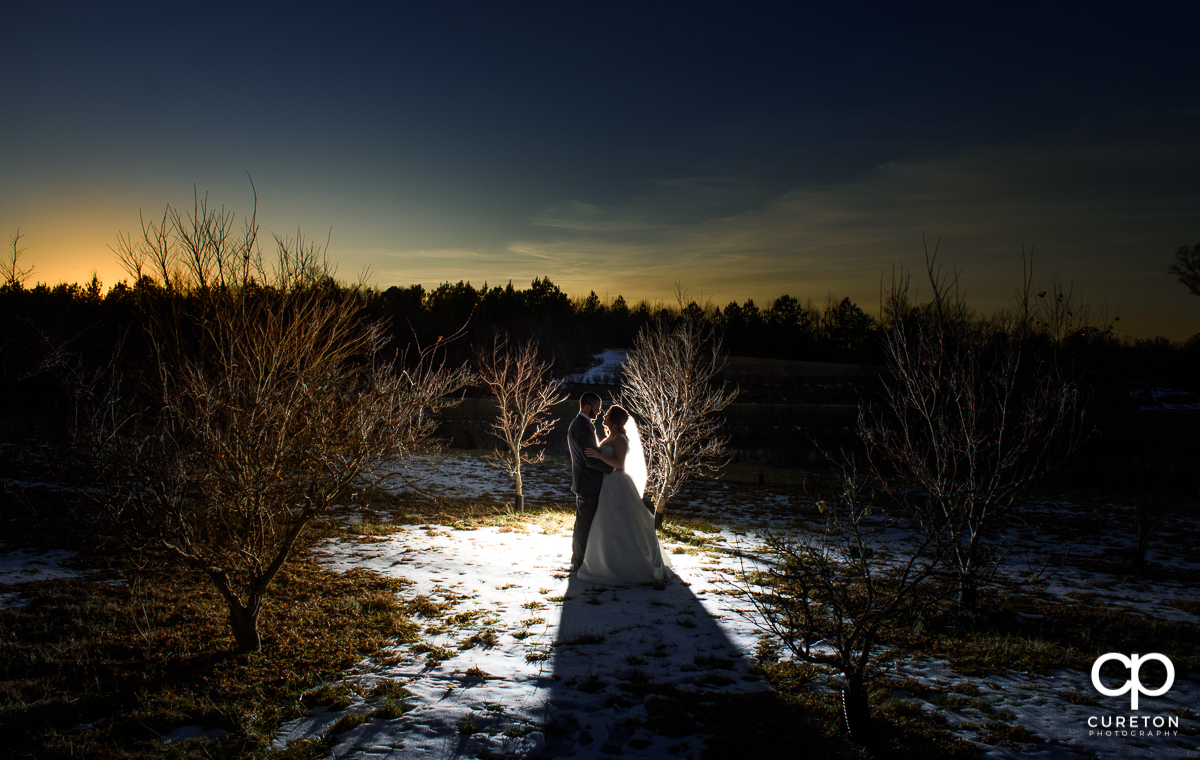 Bride and groom in the snow after their wedding ceremony at The Arbors in Cleveland,NC.