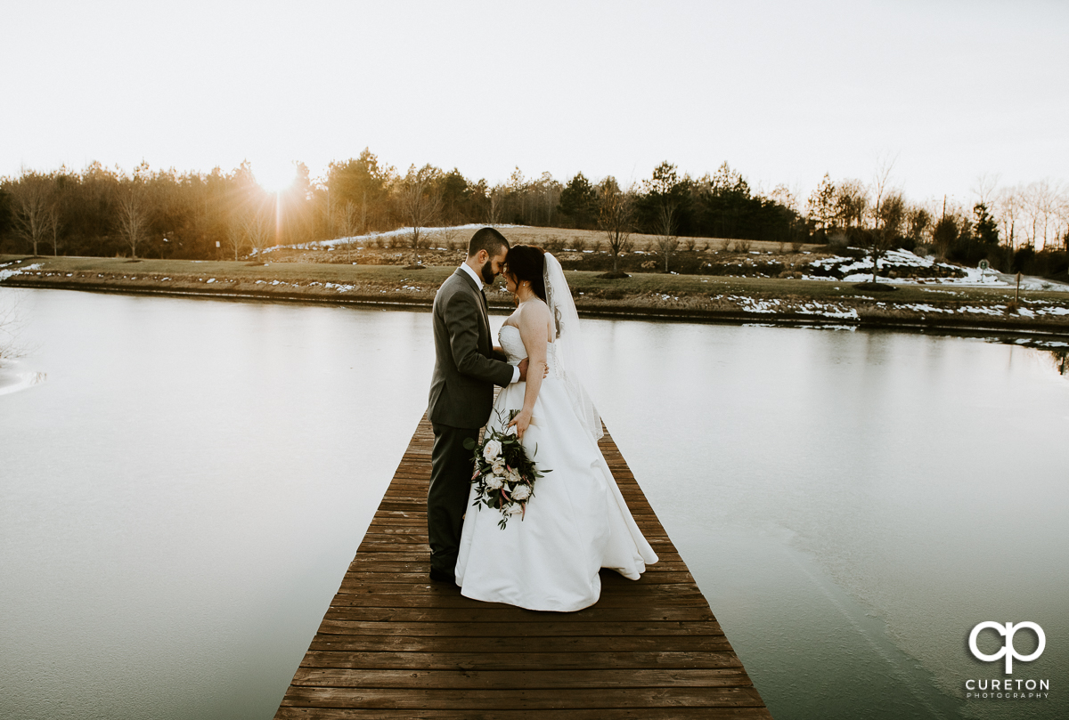 Bride and groom on a pier during their wedding near Lake Norman North Carolina.