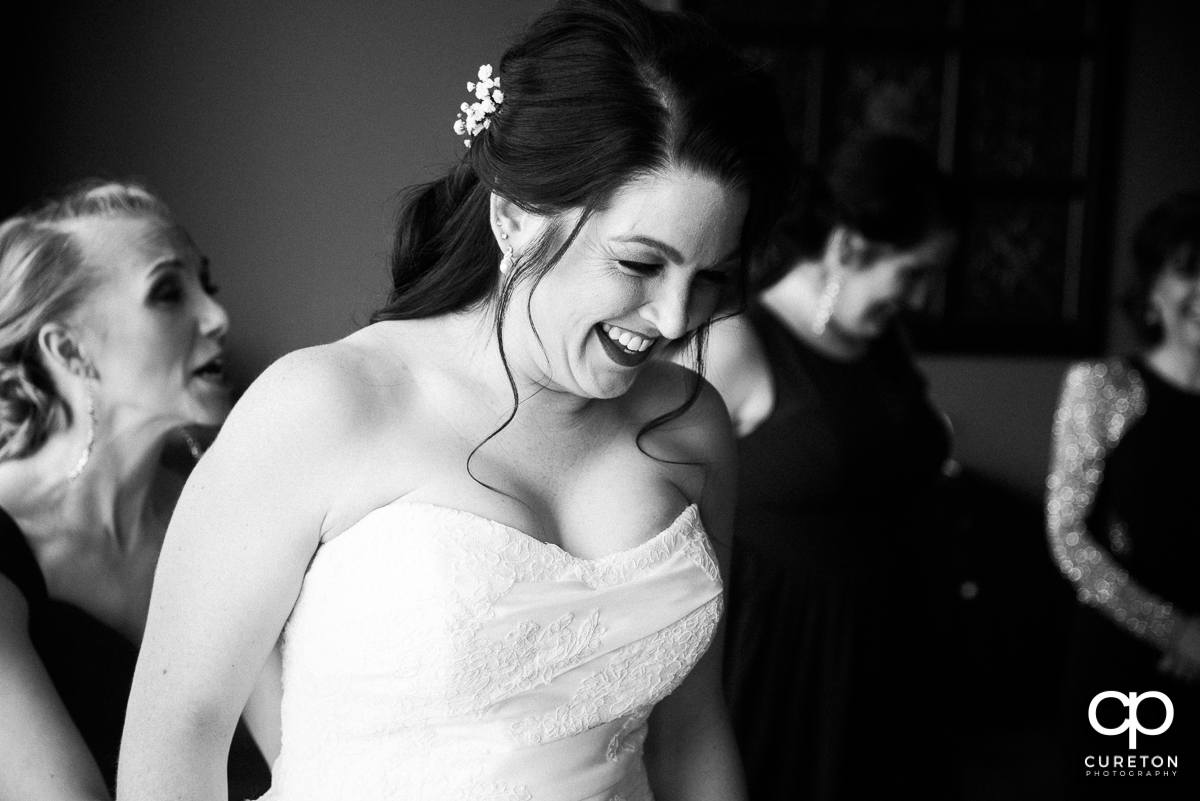 Bride laughing while getting ready.