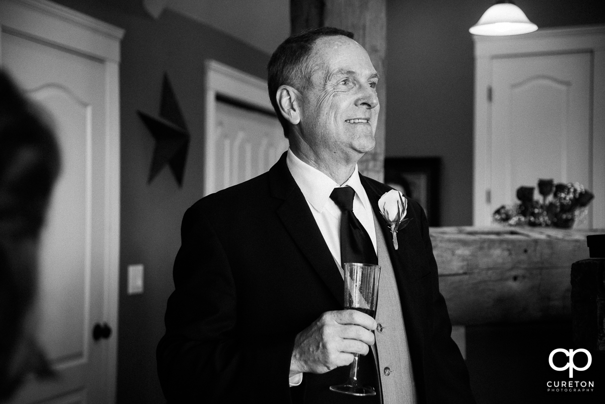 Bride's father looking at his daughter in her dress for the first time.
