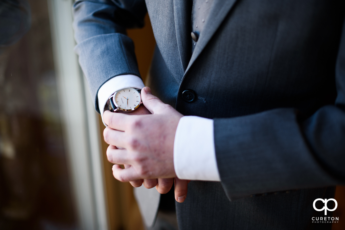 Groom looking at his watch.