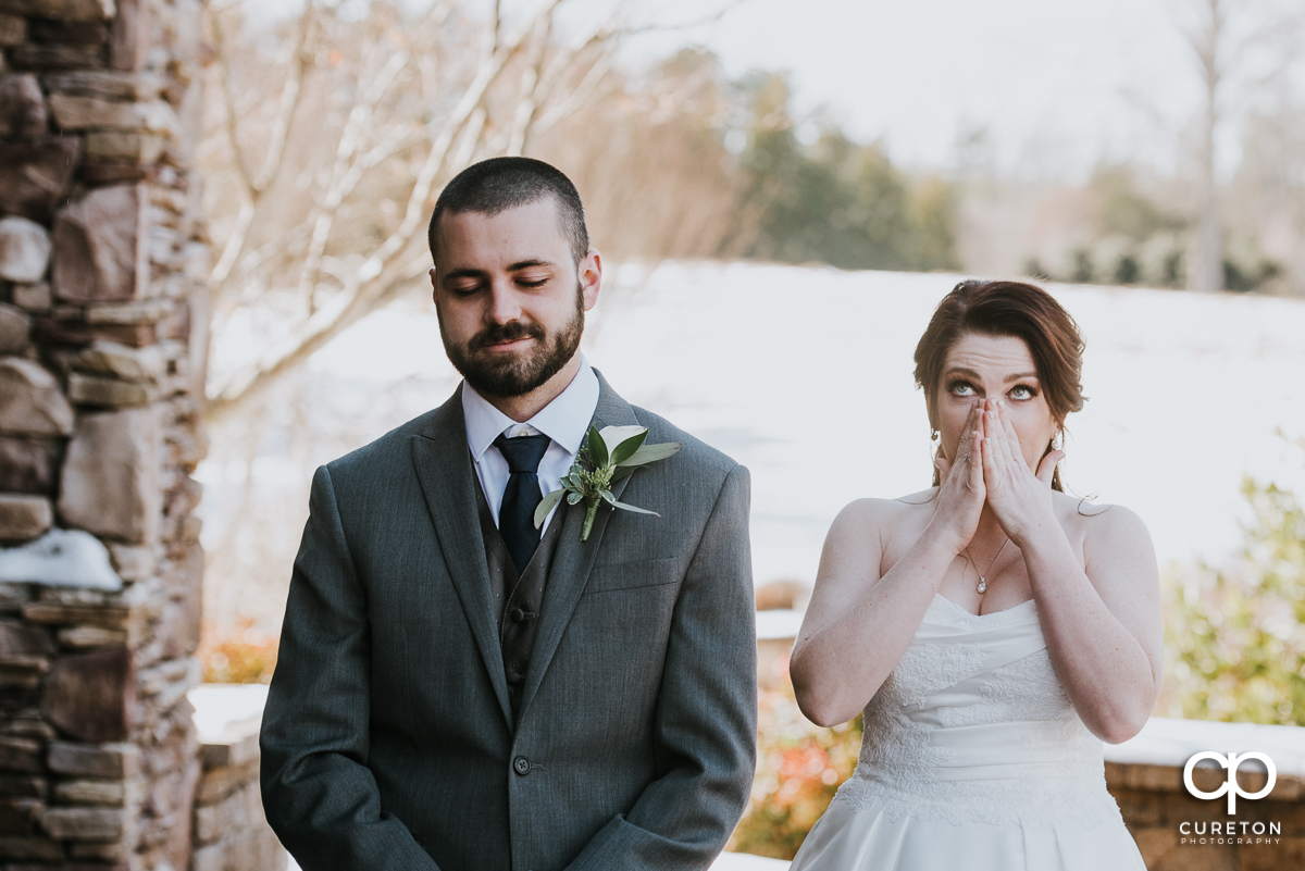 Bride getting emotional during her first look with her groom before the ceremony.