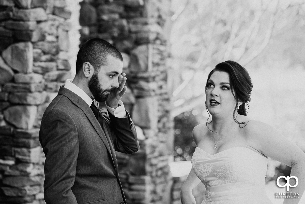Groom getting emotional after seeing his bride during a pre-wedding first look.
