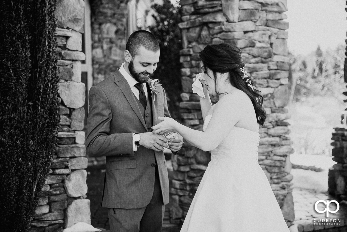 Bride and groom sharing a tissue after their first look before their Cleveland,NC wedding.