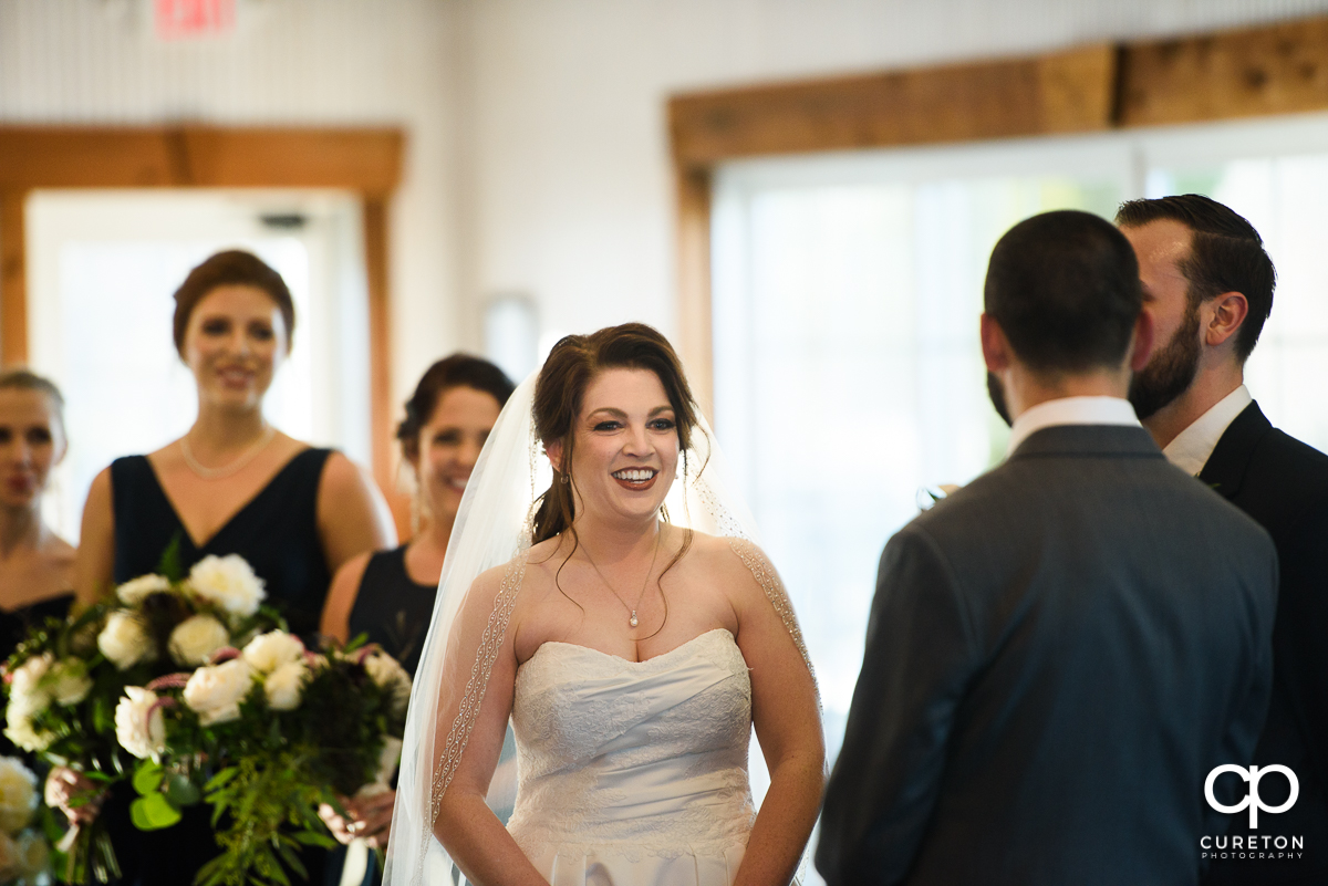 Bride smiling during the ceremony.