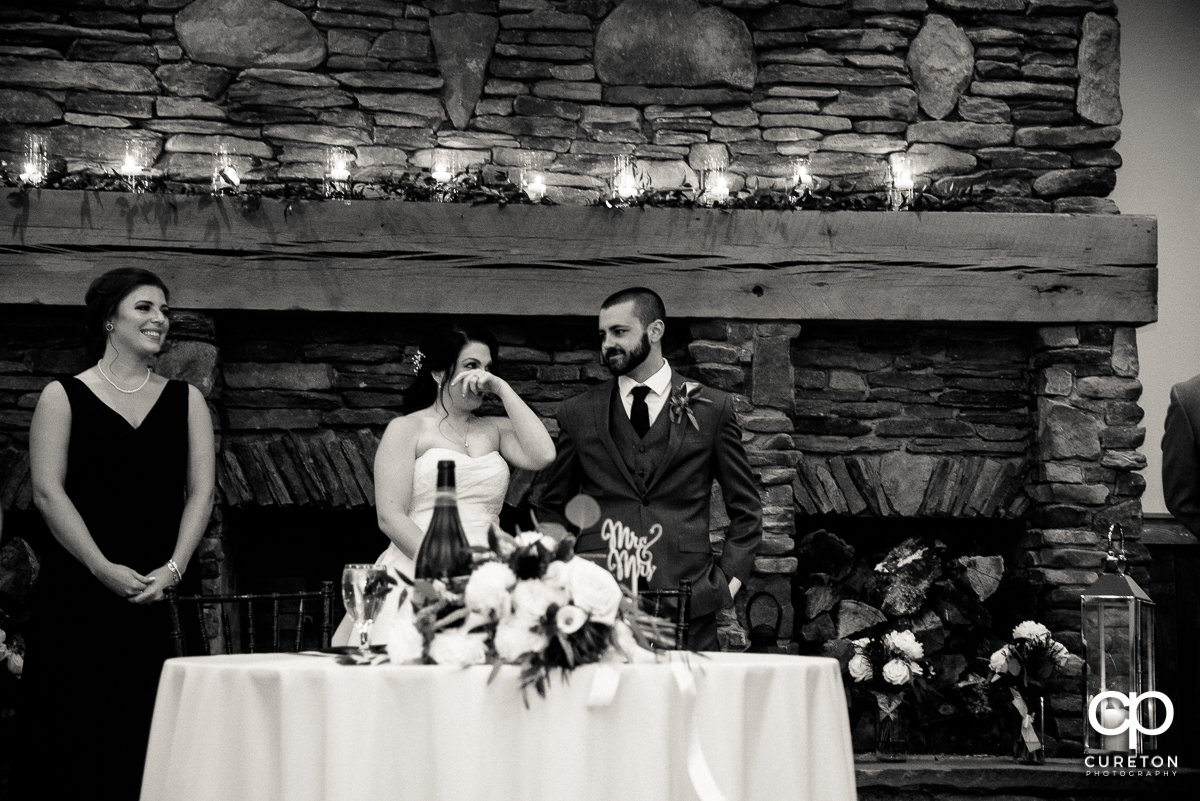 Bride tearing up hearing her fathers speech at the reception.