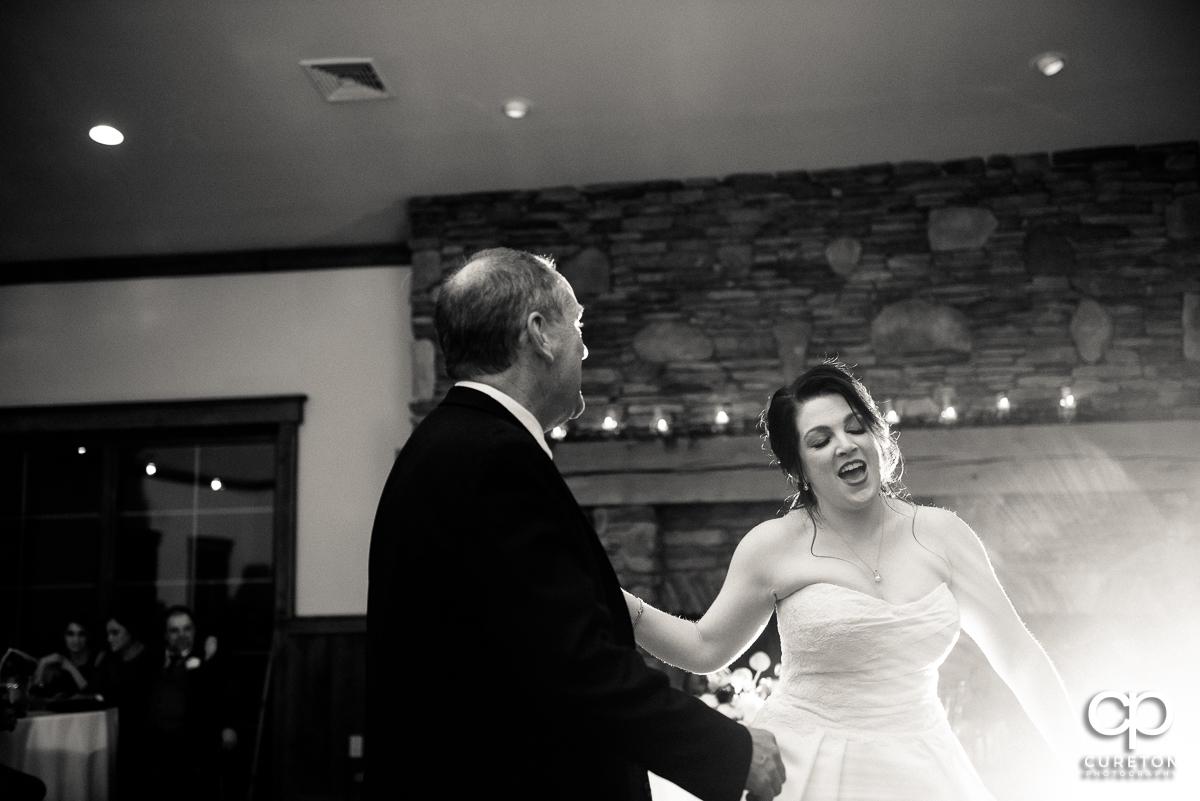 Bride and her dad dancing.