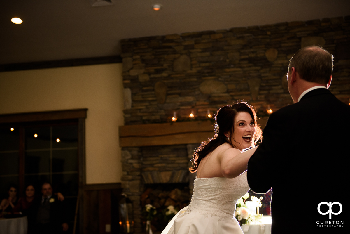 Bride smiling during the dance with her father.