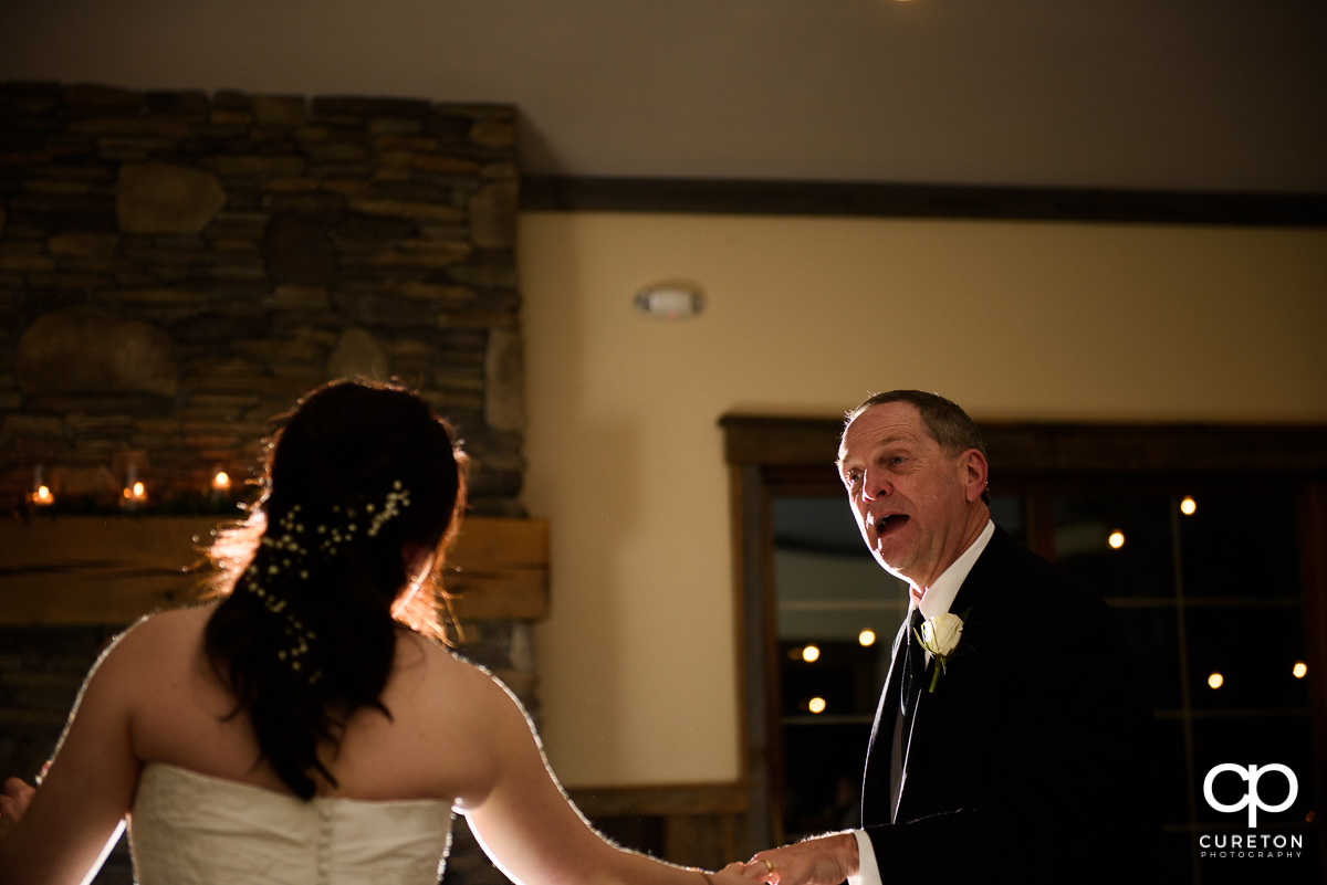Bride's father dancing with his daughter.
