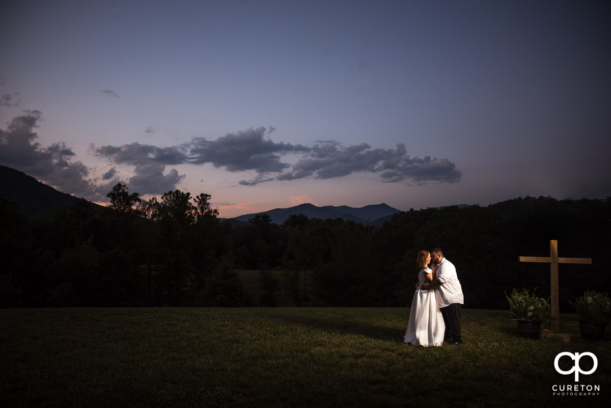 Bride and groom dancing an sunset after their Asheville NC outdoor wedding.