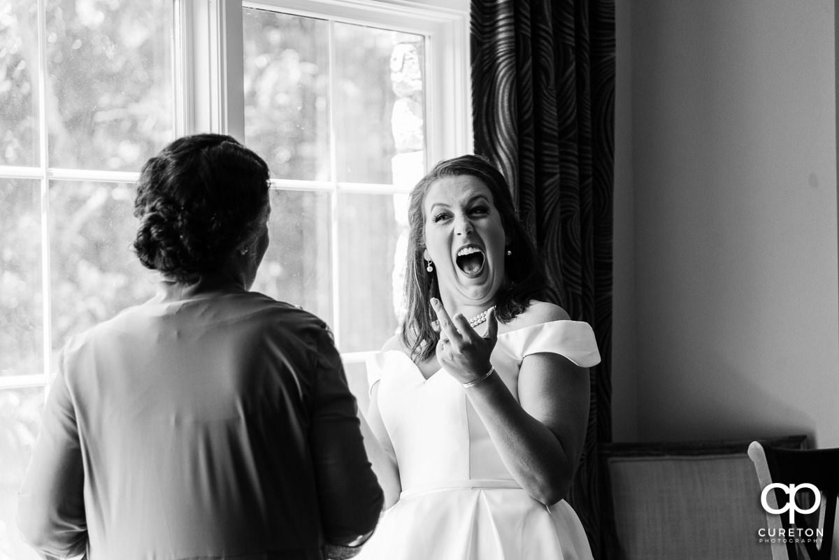 Bride flipping off her mom.