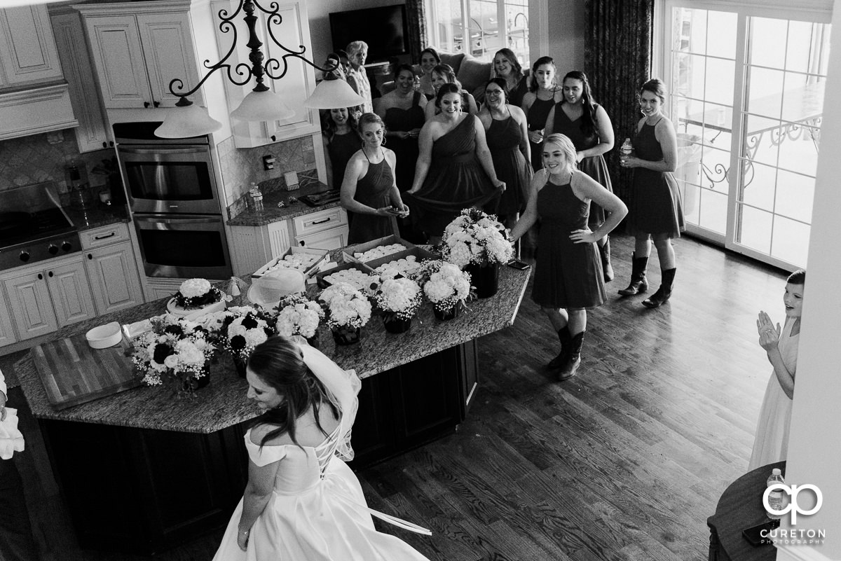 Bridesmaids seeing the bride for the first time.