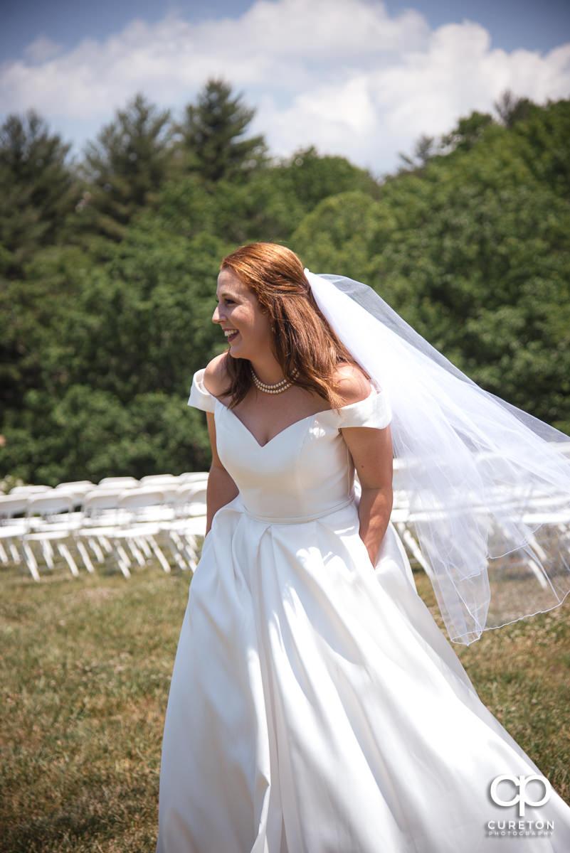 Bride in a field.