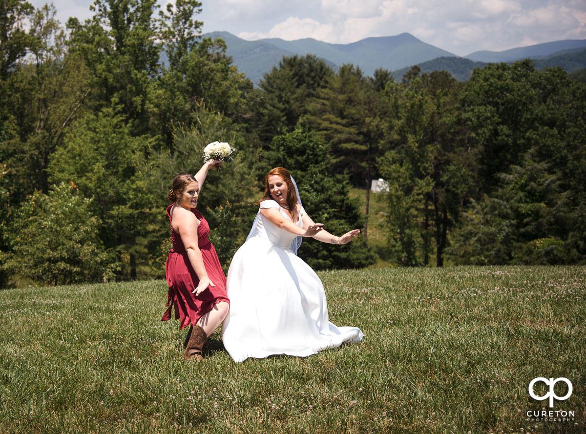 Bride and bridesmaid dancing.
