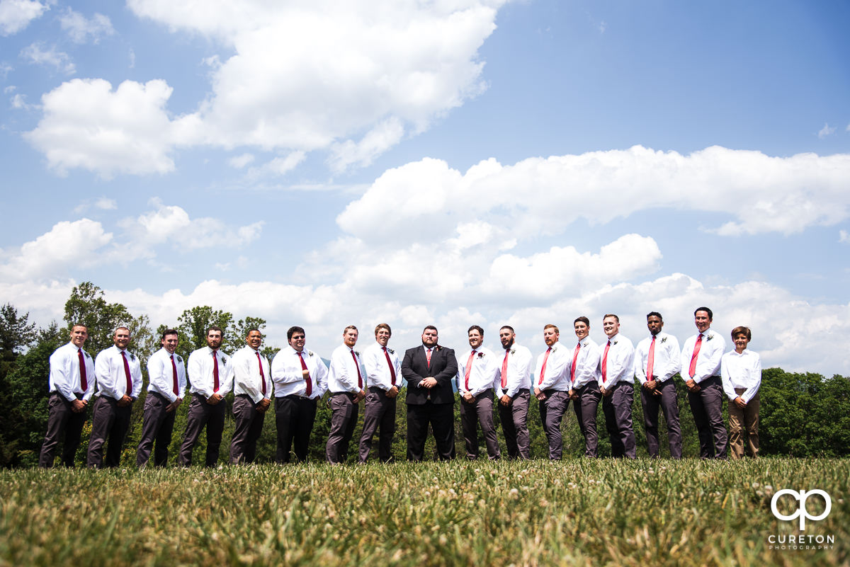 Groom and groomsmen in a field in Asheville,NC.