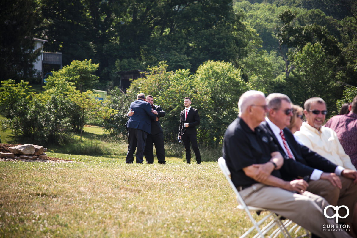 Groom hugging his dad before the ceremony.