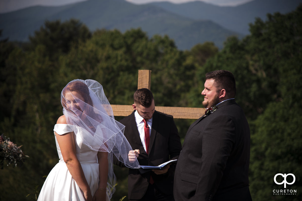 Bride laughing during the outdoor wedding ceremony in Asheville,NC.