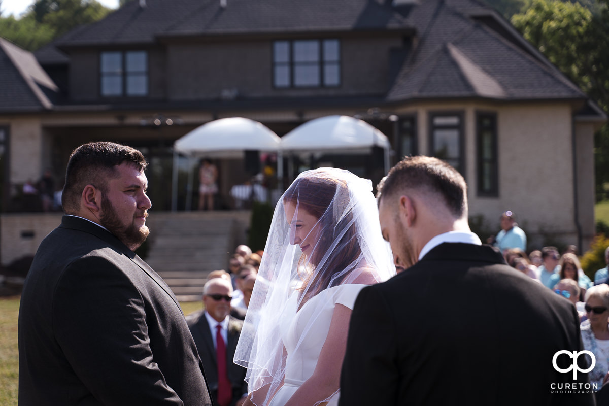Bride and groom facing the crowd during the outdoor wedding ceremony in Asheville,NC.