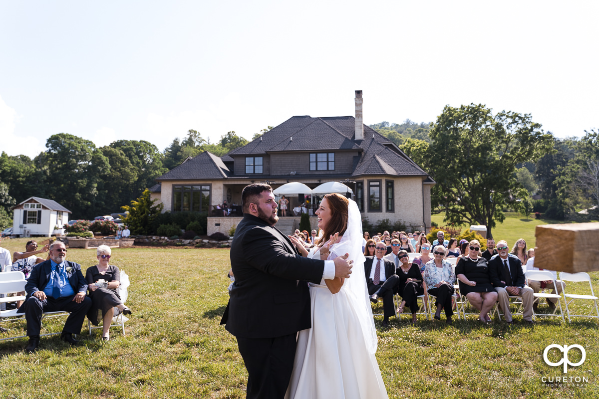 The moment before the first kiss during the outdoor wedding ceremony in Asheville,NC.
