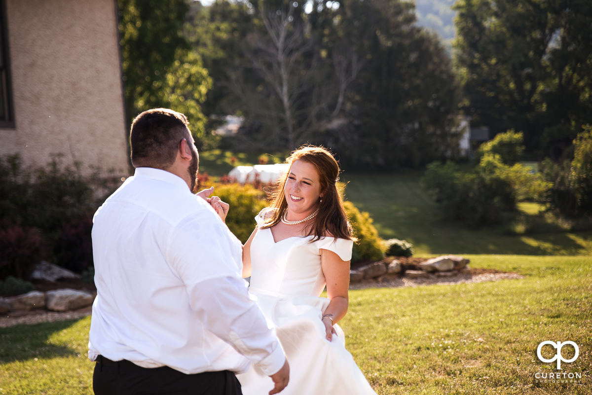 Bride smiling during the first dance at the Asheville,NC outdoor wedding reception.
