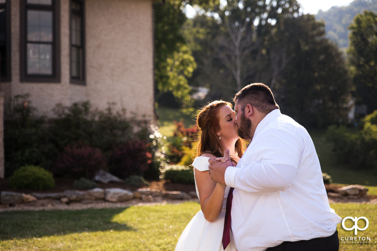 Bride and groom kissing during the first dance.