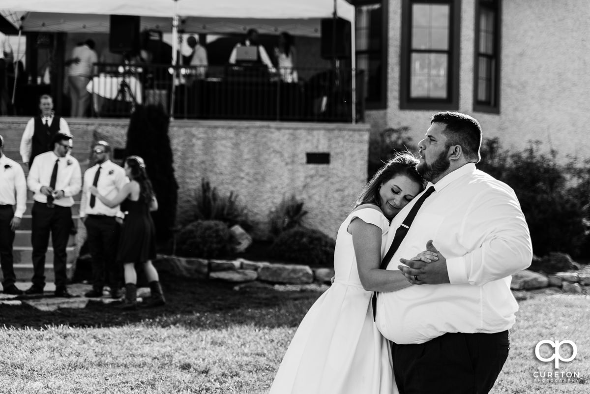 Bride dancing with her husband.