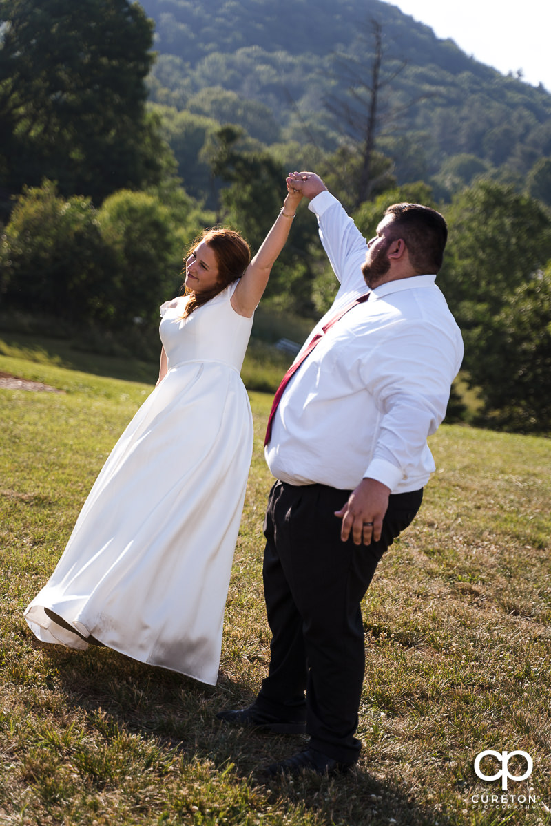 Bride and groom twirling during the first dance.