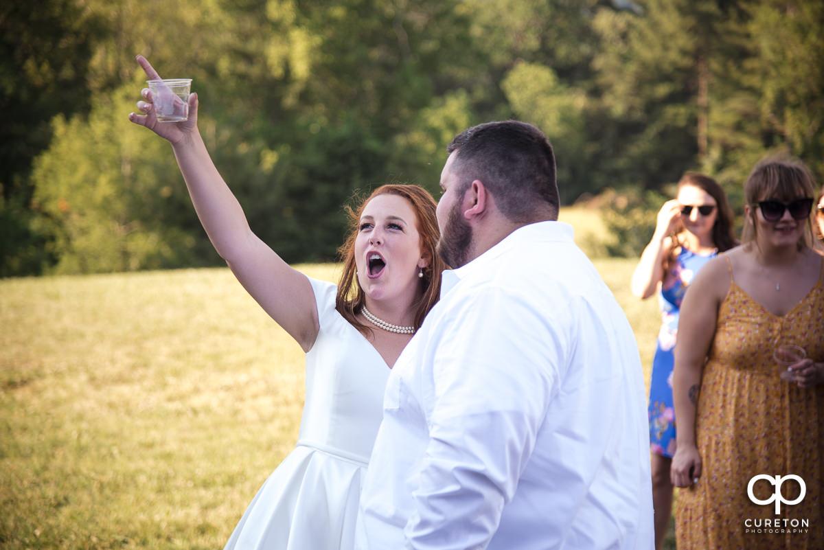 Bride cheering.