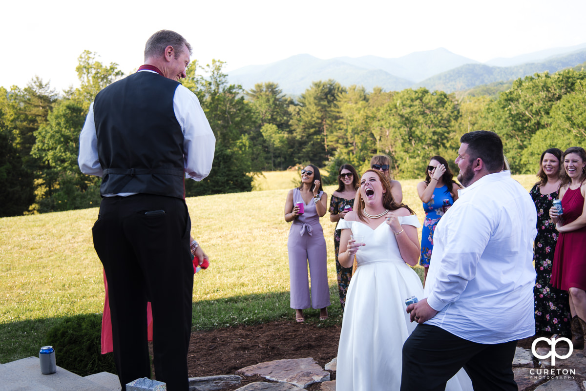Bride laughing wth the DJ.
