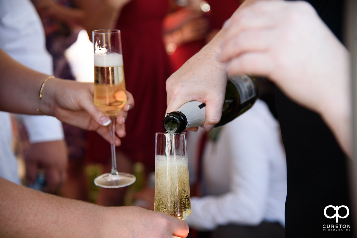 Champagne being poured.